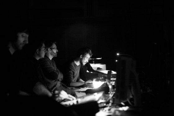 Mancianti (center) doing the electronics for the piece.