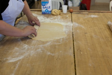 When it's all flat, roll the dough from both edges to the center, so that it creates a few flat (not tight or round) layers.