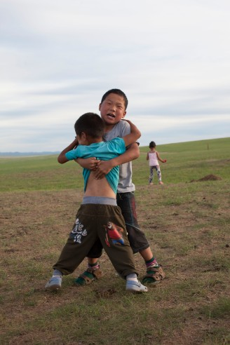 Play-wrestling with a friend. Wrestling and horseriding are both very appreciated sports in Mongolia.